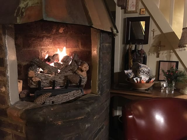 Warmth on a cold night. The hearth is the original where the coppersmith made copper stills.