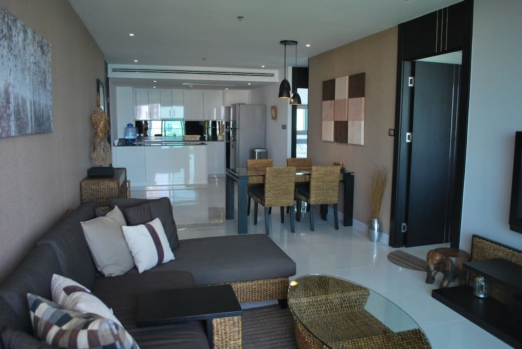 Sofa, dining area and kitchen.