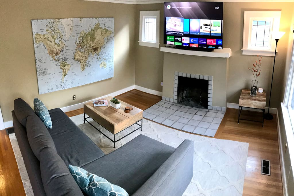 "Living room with 65"" smart TV, access to Netflix and Hulu. The couch pulls out to become a queen sized sleeper and is very comfortable!"