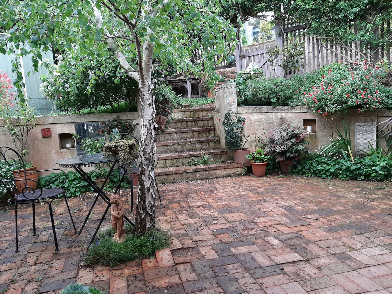 Courtyard for your use.   the stairs to Cliff Street.   Your entry is via VIEW street off Parade.    Courtyard after rain