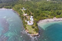 The Cabier promontory with Cabier Ocean Lodge foreground and Two Bays above and behind 60 ft above the water