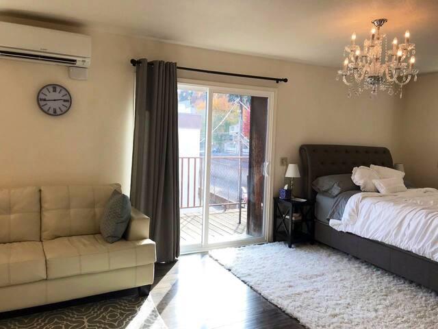 Sliding door to second floor balcony and love seat sized sofa