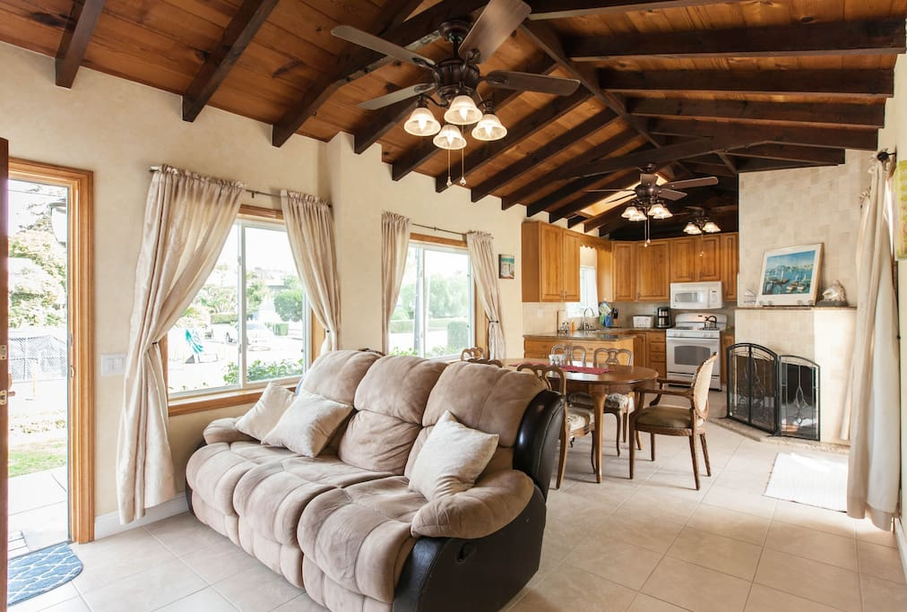 Family room, old high beam ceilings, kitchen.
