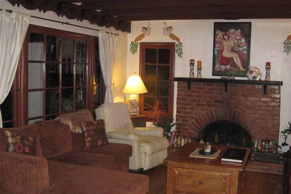 Living room with wood beam ceiling.