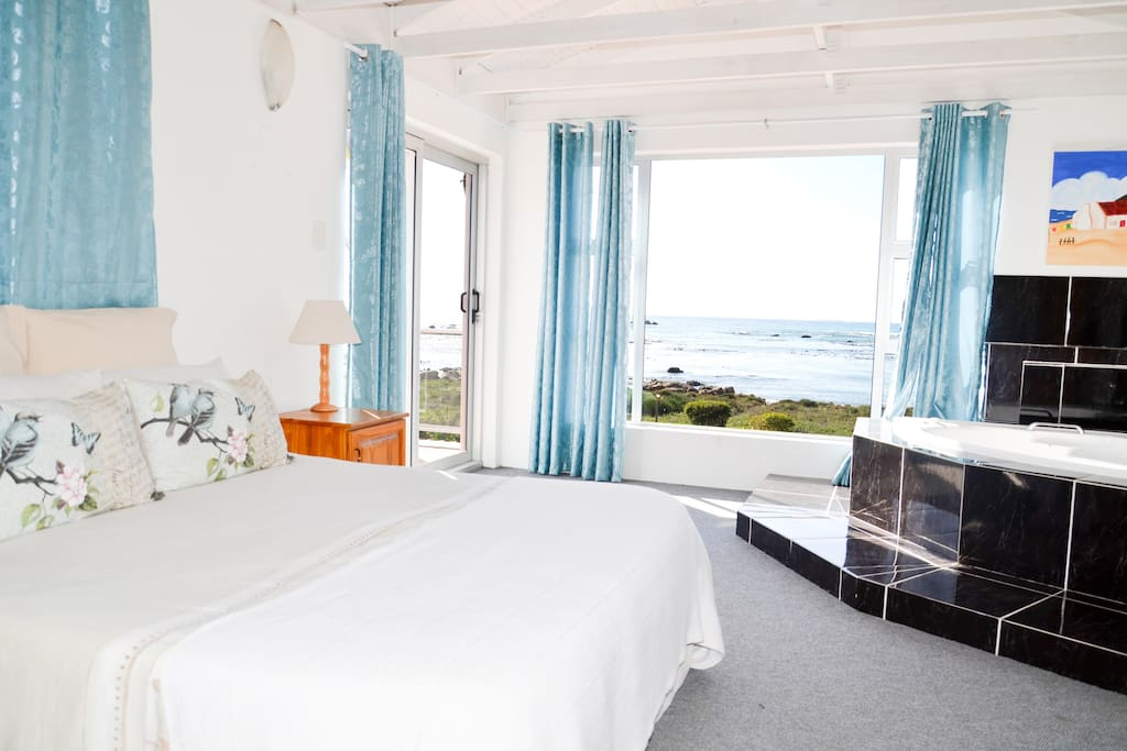 Masterbedroom with open bath area and full beach view