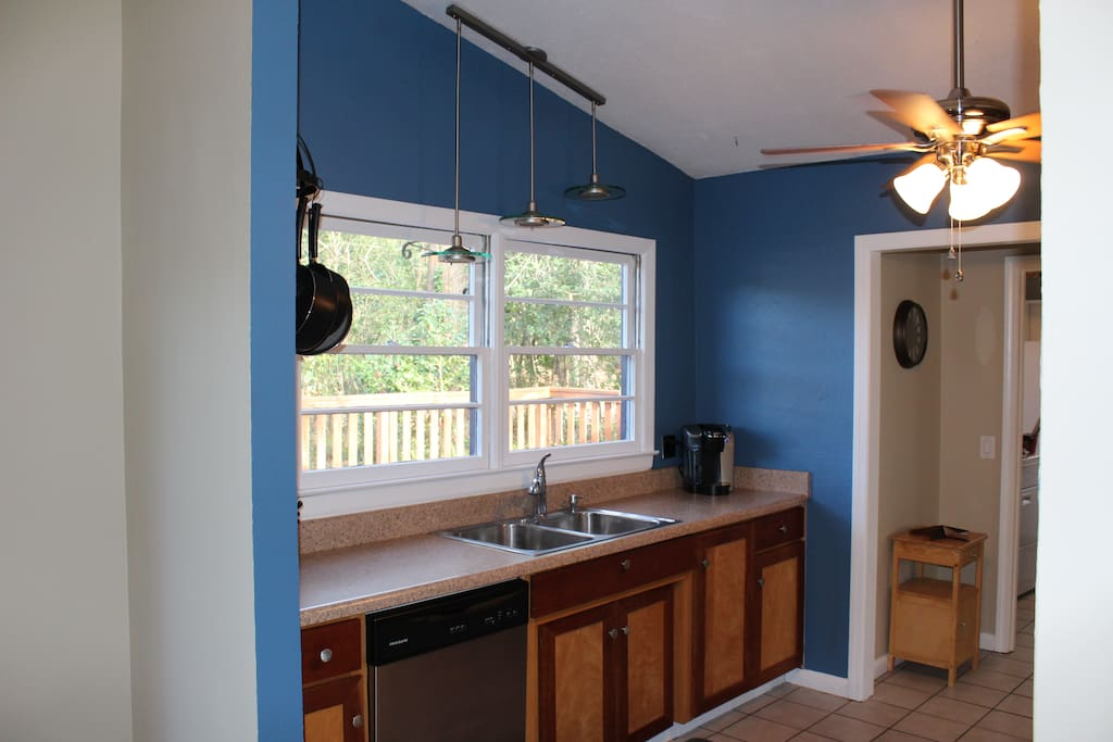 Open and breezy kitchen with dishwasher, Keurig coffee machine and beautiful views onto the back deck and fenced in yard.