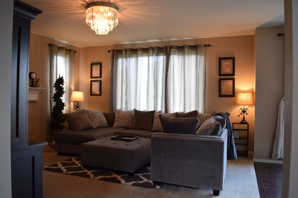Comfortable, New, large U Sectional sofa next to Gas Fireplace