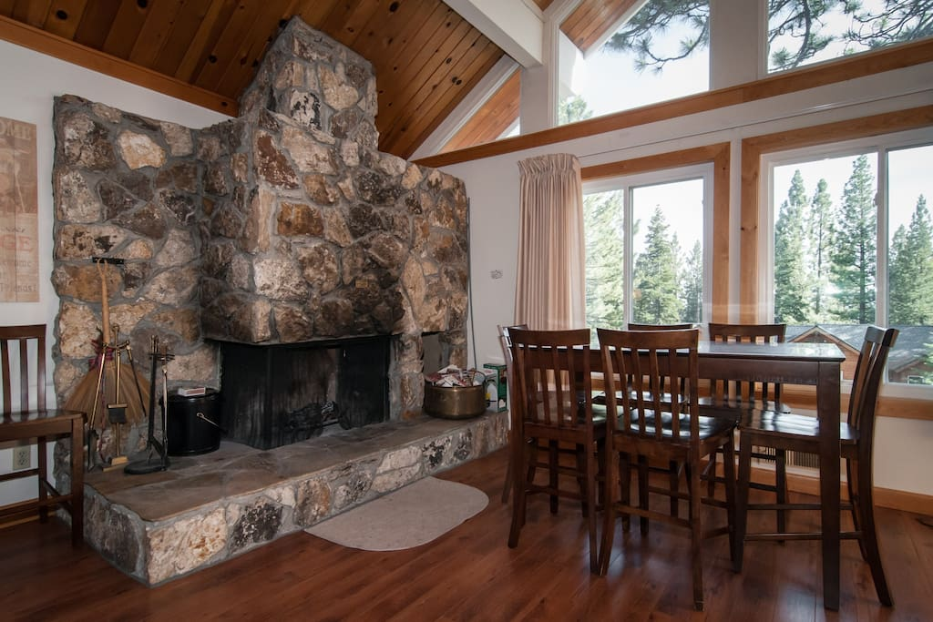 upstairs family room with wood burning fireplace