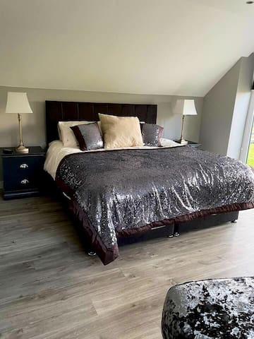 Master bedroom with super king bed with en-suite