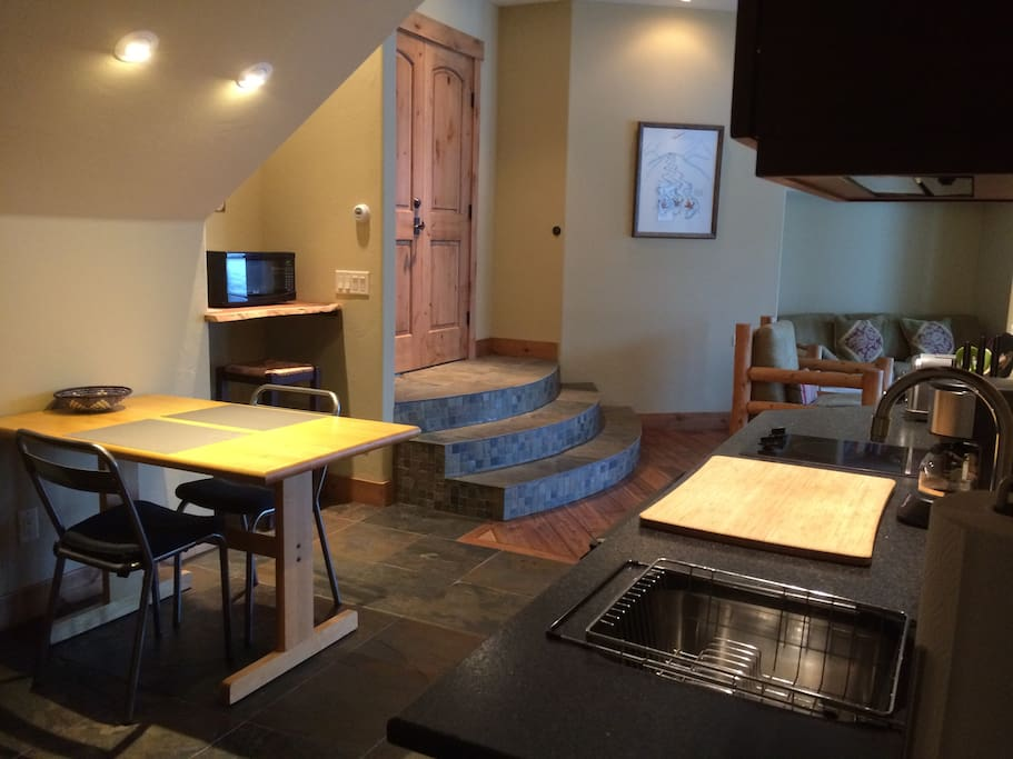Dining area and kitchenette includes, micro, mini fridge and 2 burner stove top, coffee maker and toaster.