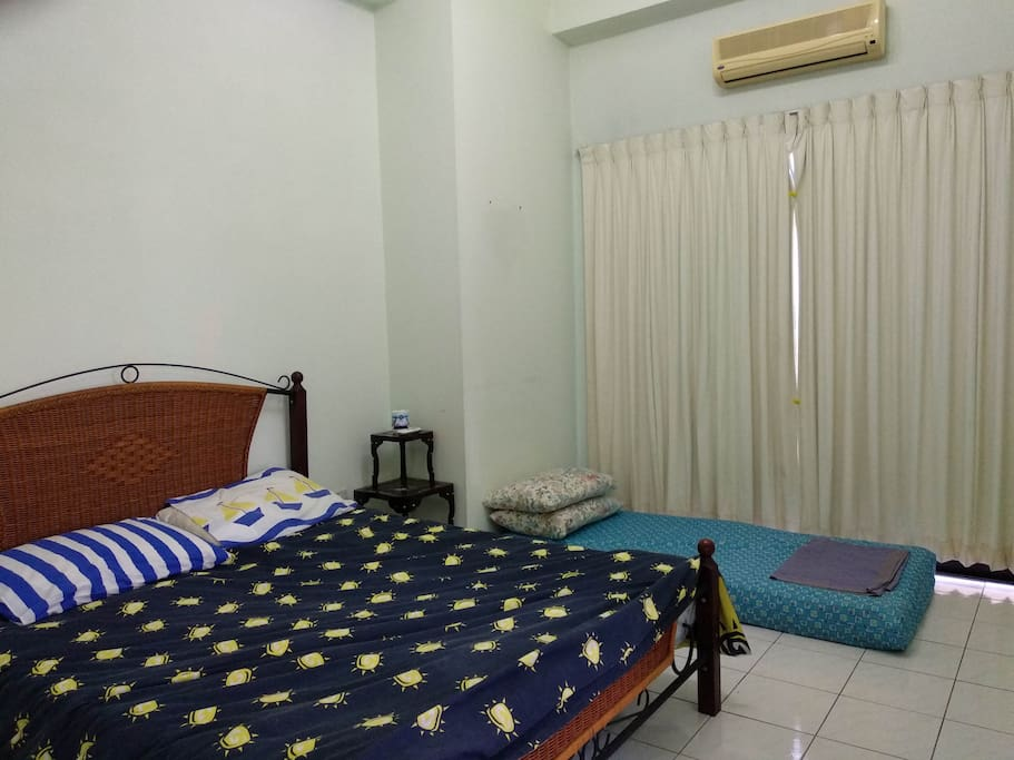 Room 1: Queen bed, floor mattress, air con