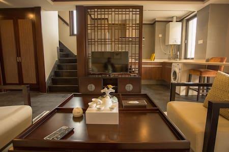 丽江金茂雪山语公寓 - Лицзян