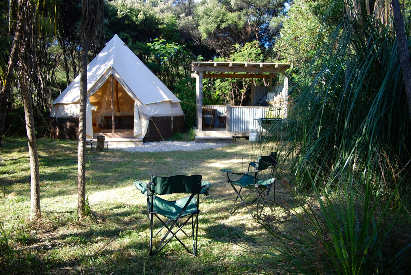 Your tent and private kitchen set in your own little clearing in the bush