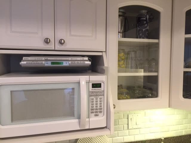 Microwave and under counter stereo.