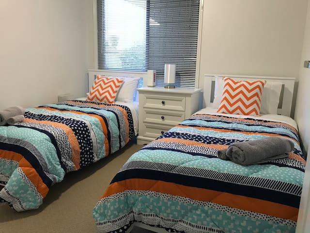 Comfy twin beds in 3rd bedroom.