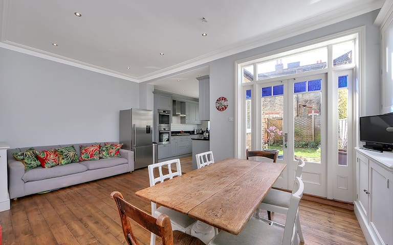 Spacious, light open plan kitchen, living and dining area which opens out onto a South Facing kitchen.