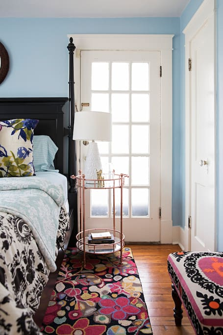 French door, closet and luggage ottoman in king bedroom