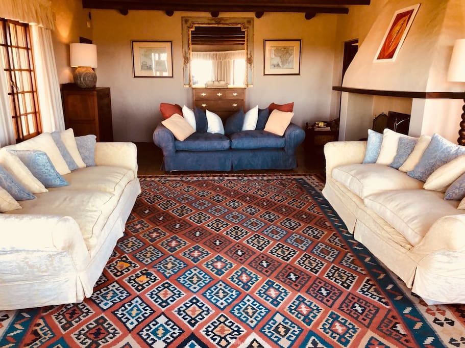 Relax in the sitting room and enjoy the beautiful views