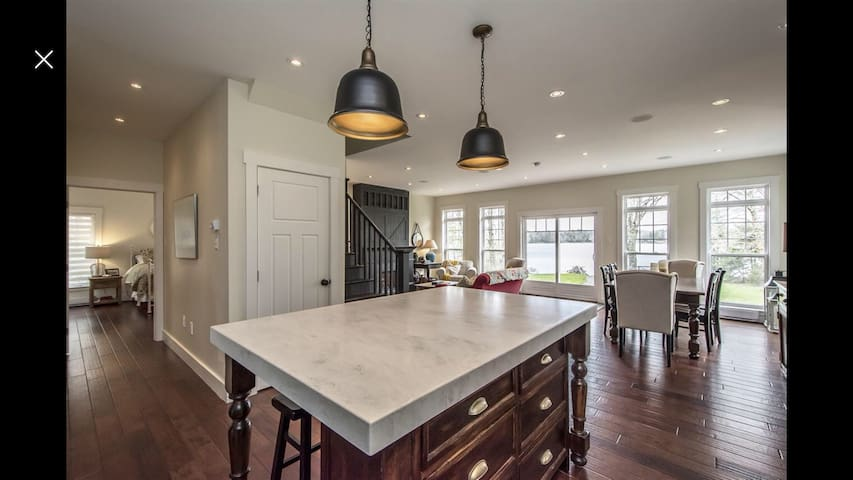 Kitchen, living space with views of the lake in every space.