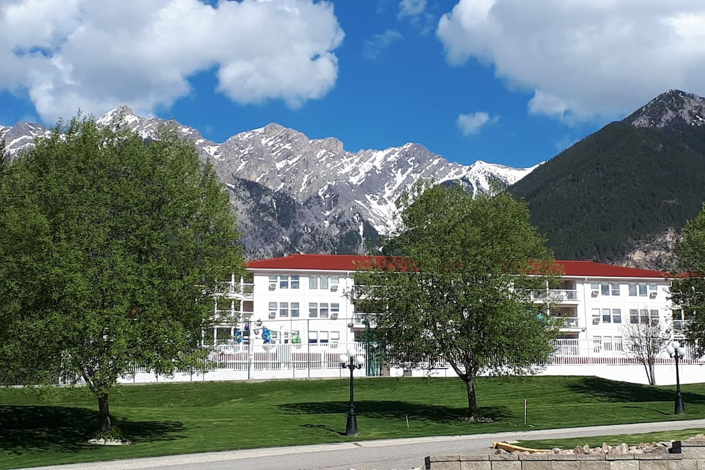 View of hotel building with Rocky Mountains in background