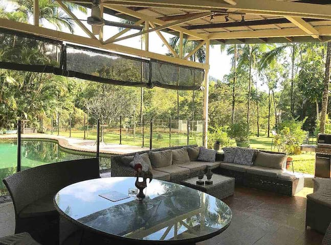 Outdoor lounge and patio overlooks deep inground pool for your use.