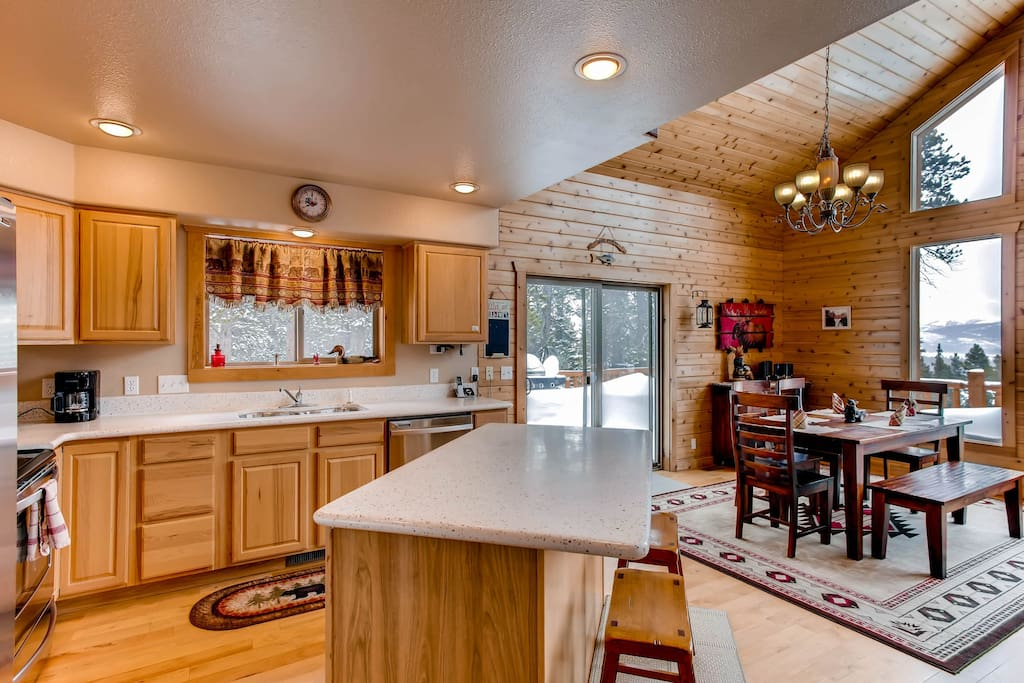 The kitchen has lots of counter space and easy access to the dining room.