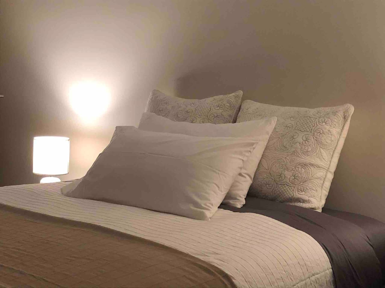Clean sheets and pillows are provided