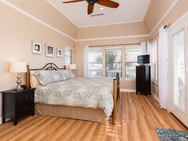 Spacious master suite with tempurpedic mattress and HD television.