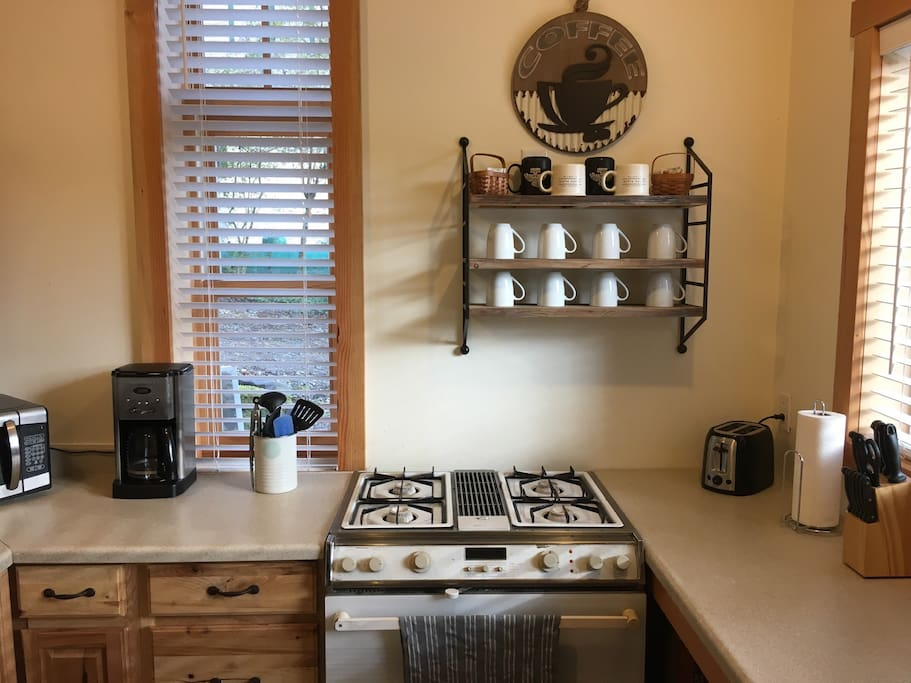 The bright and clean kitchen comes fully stocked and has a gas range, microwave, coffee maker, and toaster.
