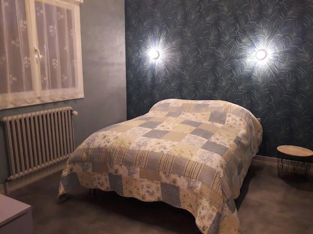 Chambre bleue chez l'habitant