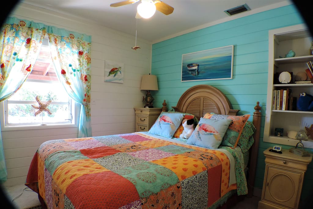 Fourth Bedroom: The Sea Turtle Room has a blackout shade & new queen sized bed & box spring (Sept 2018). There's also a ceiling fan, clock with two USB ports, an accordion door for privacy, plenty of drawers, & a clothing rack for personal items.