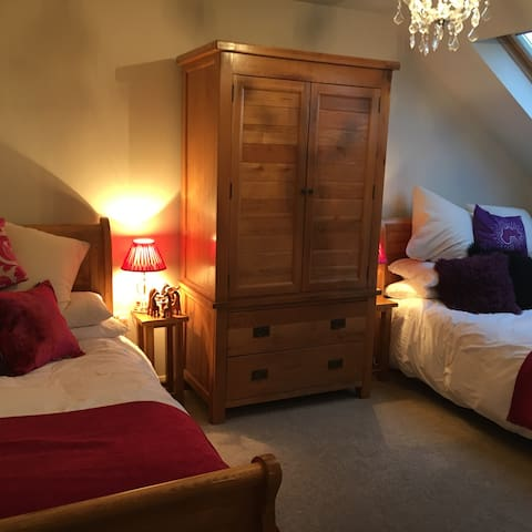 Two comfortable solid oak double beds and solid oak furniture