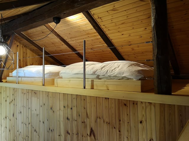 Room 2 with two double beds in the mezzanine