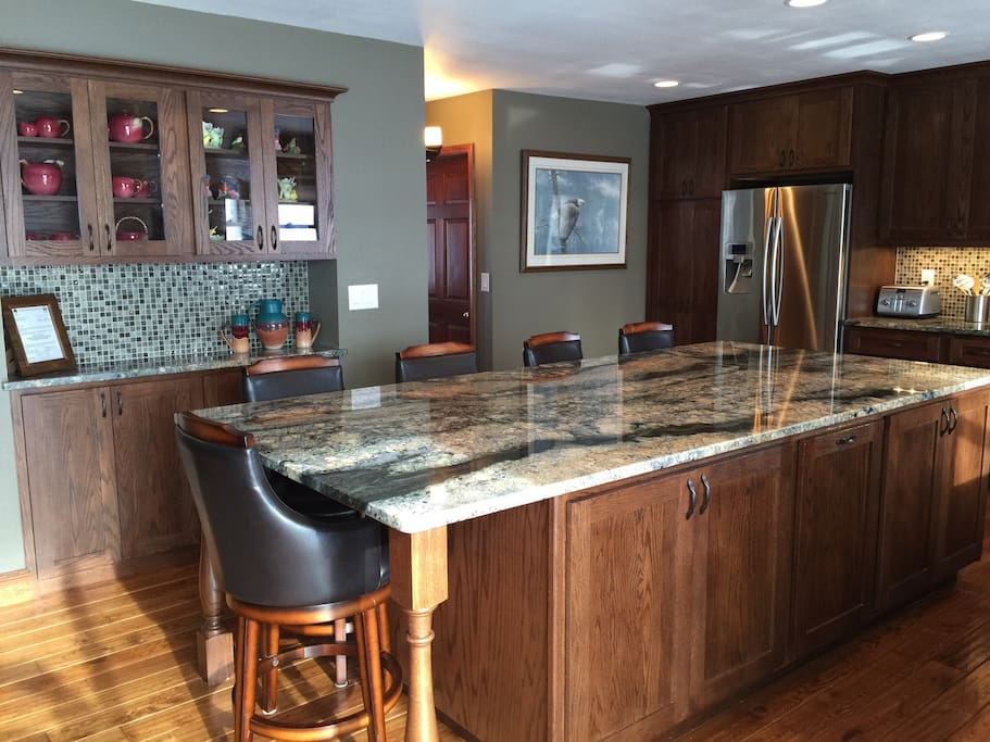 Beautiful custom delerium granite kitchen with new stainless steel appliances.