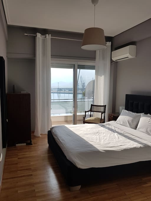 Bright bedroom with vintage touches. Large double bed with luxury comfortable matress