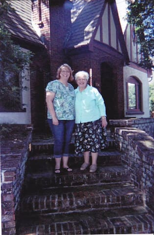 Nancy, your hostess, with her mom, Jean, standing on the steps of Holly House.