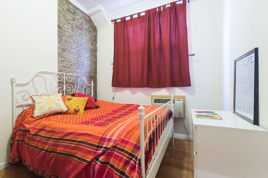 The one-bedroom features a bright, comfy Queen-size bed with lots of natural light from the windows.
