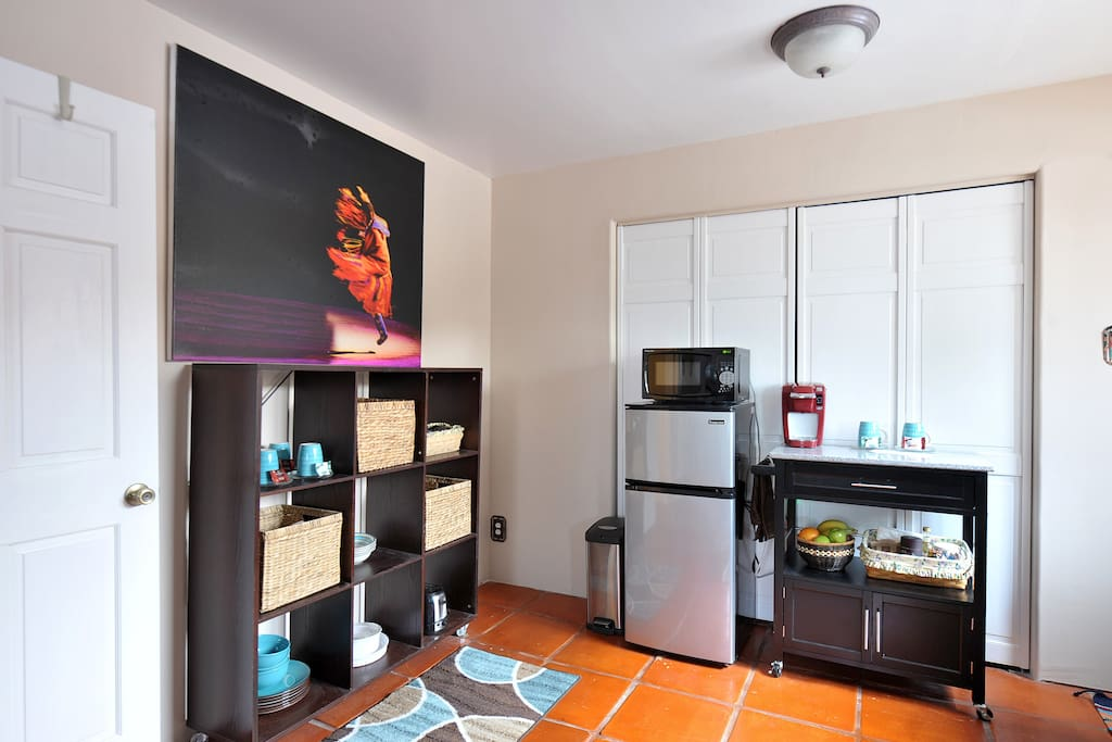 Kitchenette area with refrigerator, microwave and a Keurig