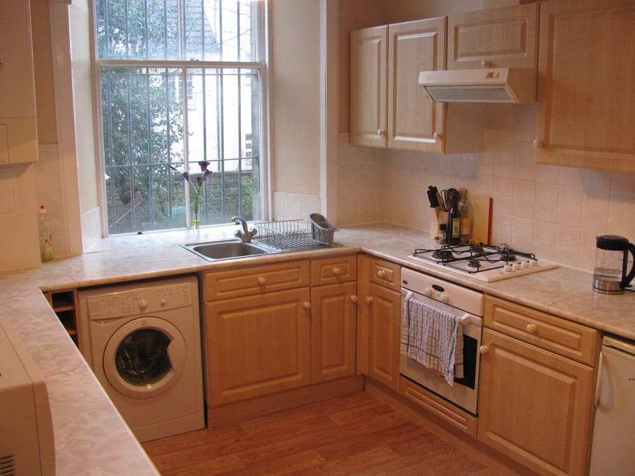 Spacious kitchen with all amenities and dining space for 4