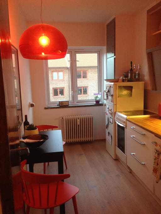 The kitchen is fully equipped, with space to enjoy your breakfast.