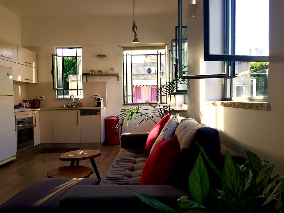 Bright, sunny and spacious living room and kitchen.