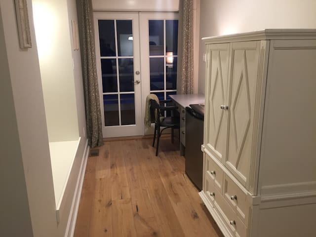 West Room - desk area and french doors to private patio overlooking the Thompson River