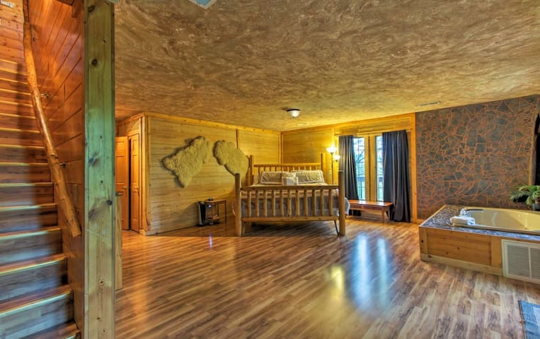 HUGE master suite downstairs with king bed and Jacuzzi tub.  (Sleeper sofa and table just added)