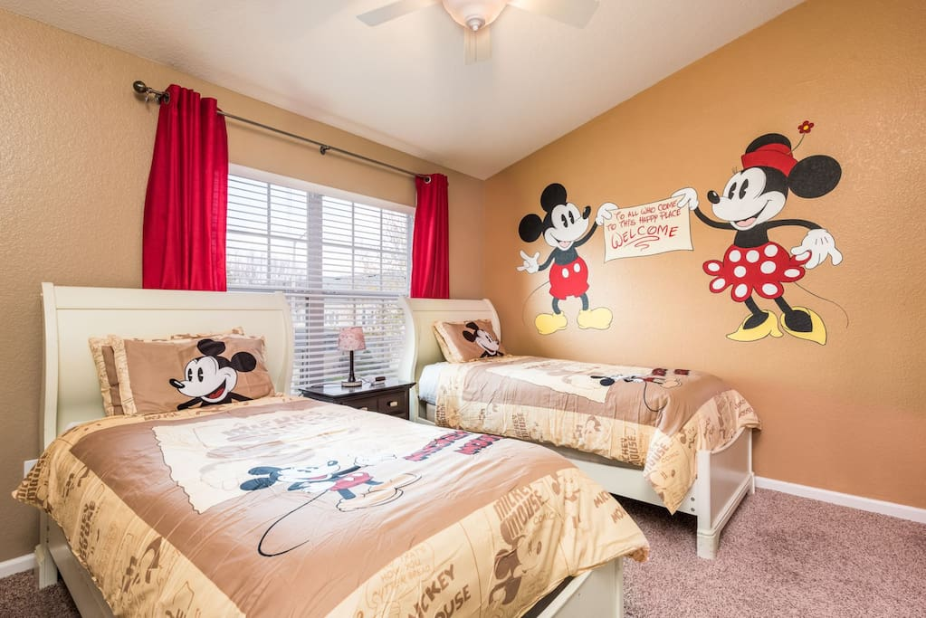 Fun themed Mickey & Minnie kids bedroom with twin beds