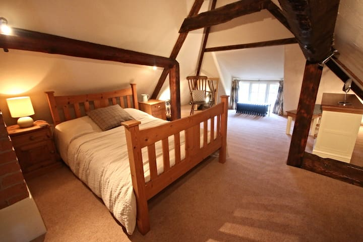 The converted hay loft with oak A frame beams