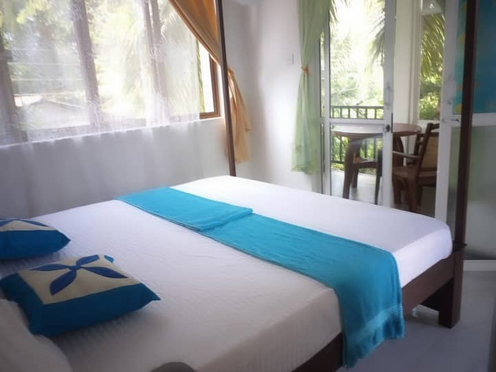 Rai Family Guest - Deluxe Double Room with Balcony