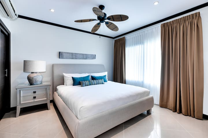 Second master bedroom with king bed and private bath.