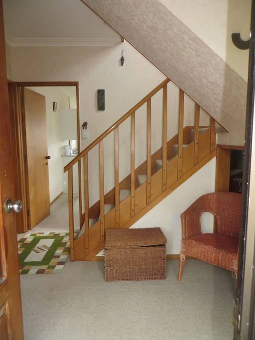 The shared front entrance, showing door to your downstairs guestroom