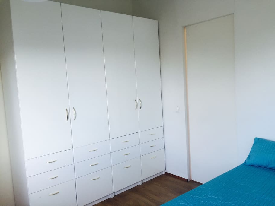 Bedroom with a closet and a bed for 2.