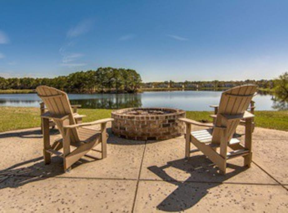 Neighborhood lake with fire pit and seating